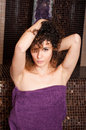 Attractive curly woman relaxing in turkish steam bath Royalty Free Stock Photo