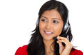 Attractive customer service representative closeup portrait of beautiful smiling adorable female business woman with phone headset Royalty Free Stock Image