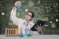 Attractive doctor examine chemical at laboratory atractive solutions lab Royalty Free Stock Photos