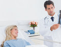 Attractive doctor showing xray to patient Stock Image