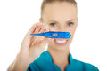 Attractive doctor with a thermometer. Royalty Free Stock Photo