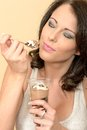 Attractive Dreamy Young Woman Eating a Chocolate Mousse Dessert Royalty Free Stock Photo