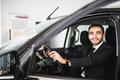 Attractive elegant happy man drive good car Royalty Free Stock Photo