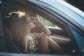 Attractive elegant woman inside car