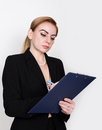Attractive energetic business woman holding pad for writing and takes notes Royalty Free Stock Photo