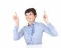 Attractive excited businesswoman pointing up Stock Image
