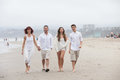 Attractive Family of four on the Beach Royalty Free Stock Photography