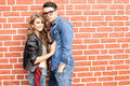 Attractive fashionable couple dressed casual Royalty Free Stock Images