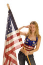 Attractive female American Patriot with flag Royalty Free Stock Photos