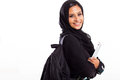 Attractive female arabic college student isolated white Royalty Free Stock Image
