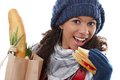 Attractive female biting sandwich at wintertime Royalty Free Stock Photography