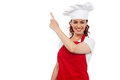 Attractive female chef pointing at copy space Stock Image
