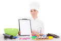 Attractive female confectioner in cook uniform sitting at the ki kitchen with clipboard isolated on white background Royalty Free Stock Photo
