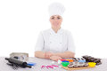 Attractive female confectioner in cook uniform sitting at the ki kitchen isolated on white Royalty Free Stock Photo