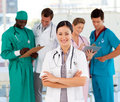 Attractive female doctor with her team Royalty Free Stock Photo