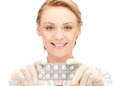 Attractive female doctor with pills picture of Stock Photography