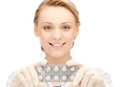 Attractive female doctor with pills picture of Royalty Free Stock Image
