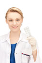 Attractive female doctor with pills picture of Royalty Free Stock Images
