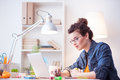 Attractive female freelancer is working at home Royalty Free Stock Photo