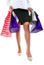 Attractive female in high heels with shopping bags Stock Photos