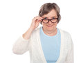 Attractive female holding her eyeglasses Royalty Free Stock Images