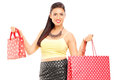 Attractive female holding shopping bags isolated on white background Stock Photos
