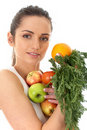 Attractive female holds bunch of fruit and veg