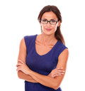 Attractive female with spectacles looking at you smiling in white background Royalty Free Stock Photo
