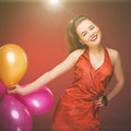 Attractive girl with air balloons stylized retro portrait of a young woman in red dress Royalty Free Stock Photo