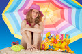 Attractive girl at the beach blond with colorful parasol Royalty Free Stock Photo