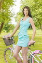 Attractive girl with bicycle in the park at beautiful spring day Stock Images