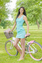 Attractive girl with bicycle in the park at beautiful spring day Royalty Free Stock Image