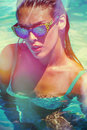 Attractive girl in bikini and sunglasses in pool Royalty Free Stock Photo