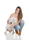 Attractive girl with a bullterrier dog bull terrier isolated on over white background Stock Photography