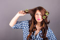 Attractive girl with curlers portrait of Royalty Free Stock Image