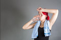 Attractive girl drinking water after exercises portrait of Royalty Free Stock Photo