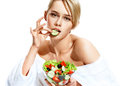 Attractive girl enjoying a healthy food and bites a piece of cucumber. Royalty Free Stock Photo