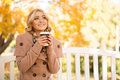 Attractive girl getting refreshment with coffee Royalty Free Stock Photo