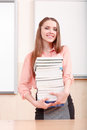 Attractive girl holding pile of books Royalty Free Stock Photo