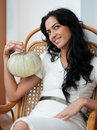 Attractive girl with holding pumpkins and smiling Royalty Free Stock Image