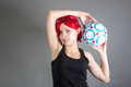 Attractive girl holding a soccer ball portrait of Stock Photos