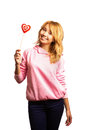 Attractive girl holding Valentine's day decoration Stock Image