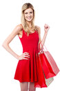 Attractive girl holding vibrant shopping bags beautiful fashion dressed in sensual attire Stock Image