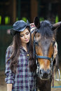 Attractive girl with horse young Stock Photography