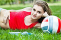 Attractive girl lay on grass Royalty Free Stock Image