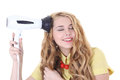 Attractive girl with long curly hair and hairdryer Royalty Free Stock Image