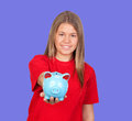 Attractive girl with money box on a blue background Stock Photography