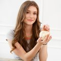 Attractive girl with moneybox cute beautiful woman Royalty Free Stock Photo