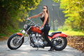 Attractive girl  on a motorbike Royalty Free Stock Photos