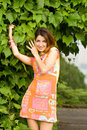 Attractive girl near the bush Royalty Free Stock Images